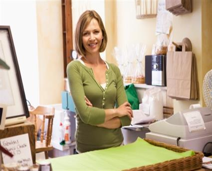 shop retail woman smiling arms crosse